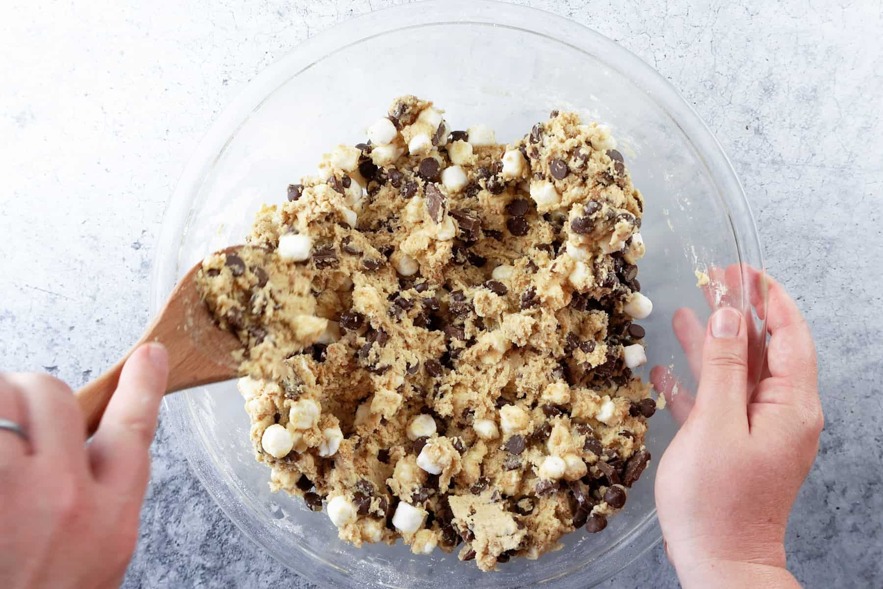 stirring in mini marshmallows and chocolate chips to batter