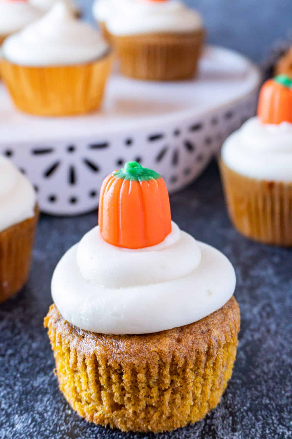pumpkin cupcake with cream cheese frosting close up