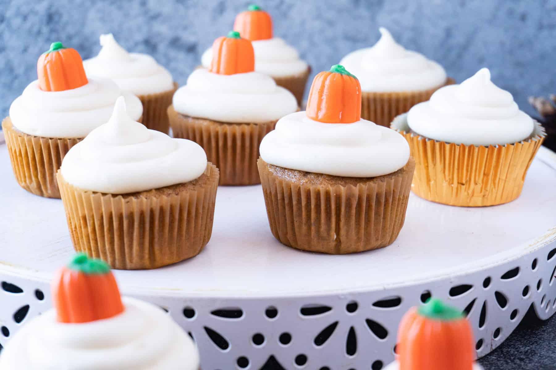 pumpkin cupcakes on a platter