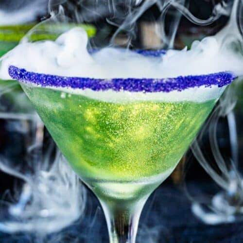 Bright Shimmery Green Drink with sugared purple rim close up
