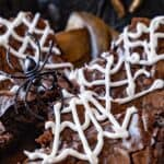 Halloween Brownies- close up of brwnies stacked with fake spider