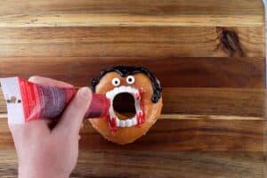 "adding gel ""blood"" to vampire donut"