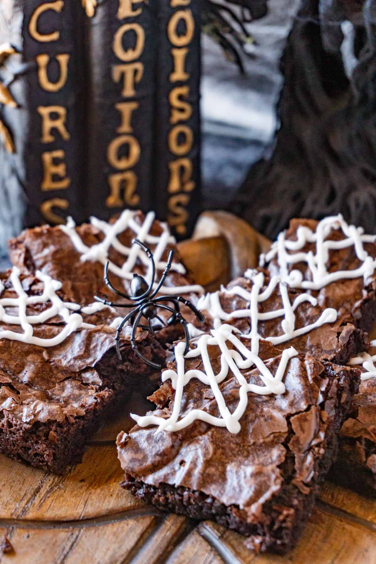 Spider web brownies on a platter