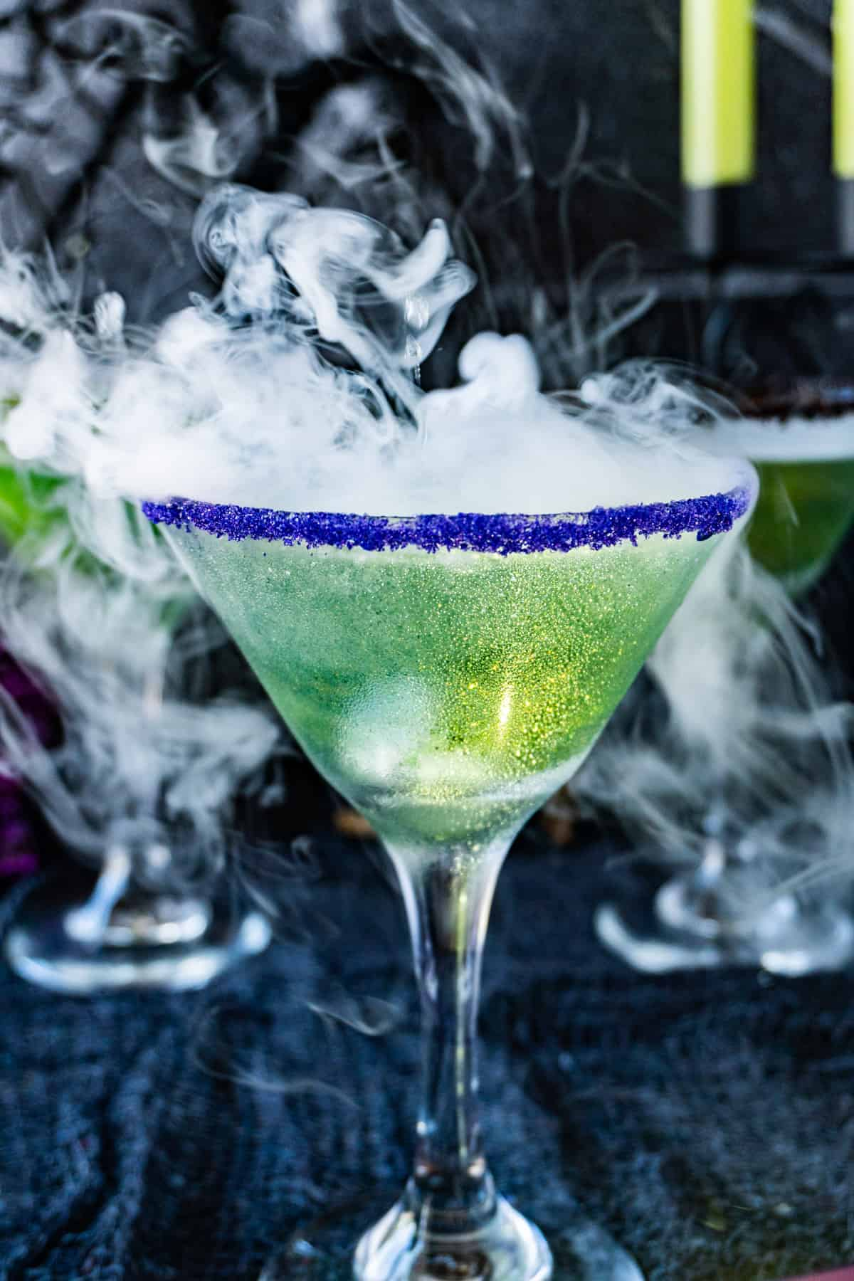 Witches Brew Cocktail with dry ice - full glass view