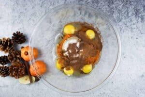 eegs, pumpkin, spices, and sugar in a bowl