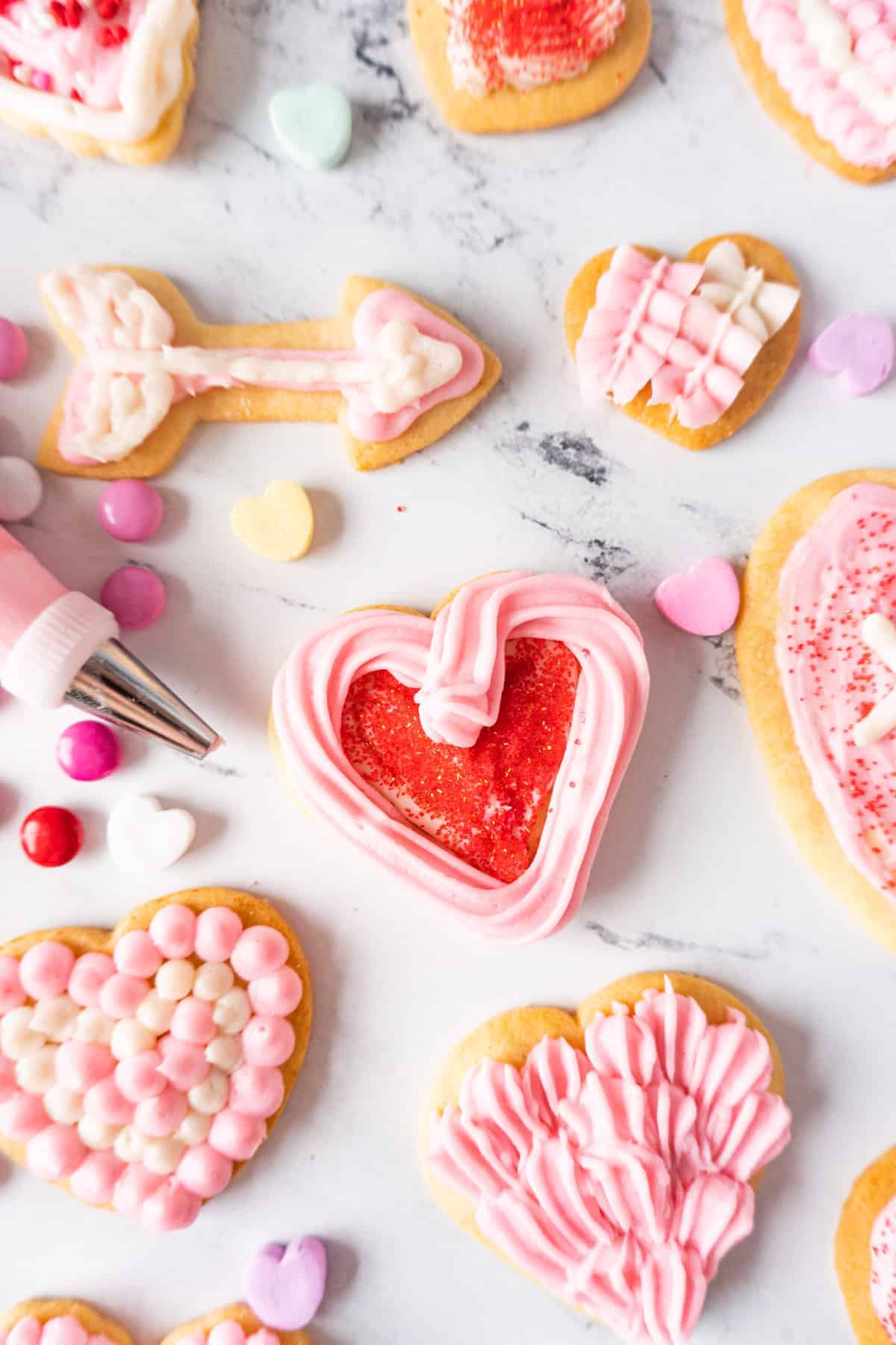 sugar cookies decorated with frosting and sprinkles