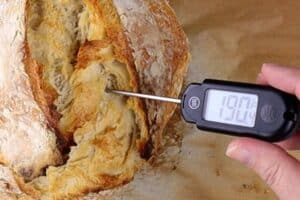 thermometer in baked bread showing 190°F