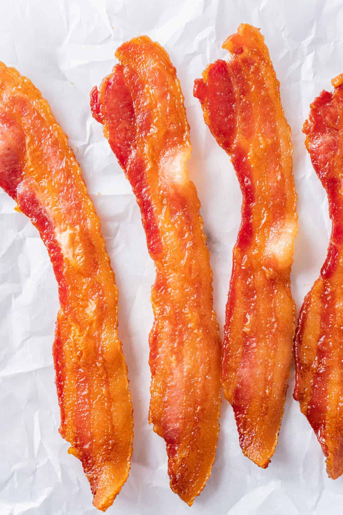 Golden Cooked Bacon on Parchment Paper