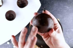 combining two halves of a chocolate shell