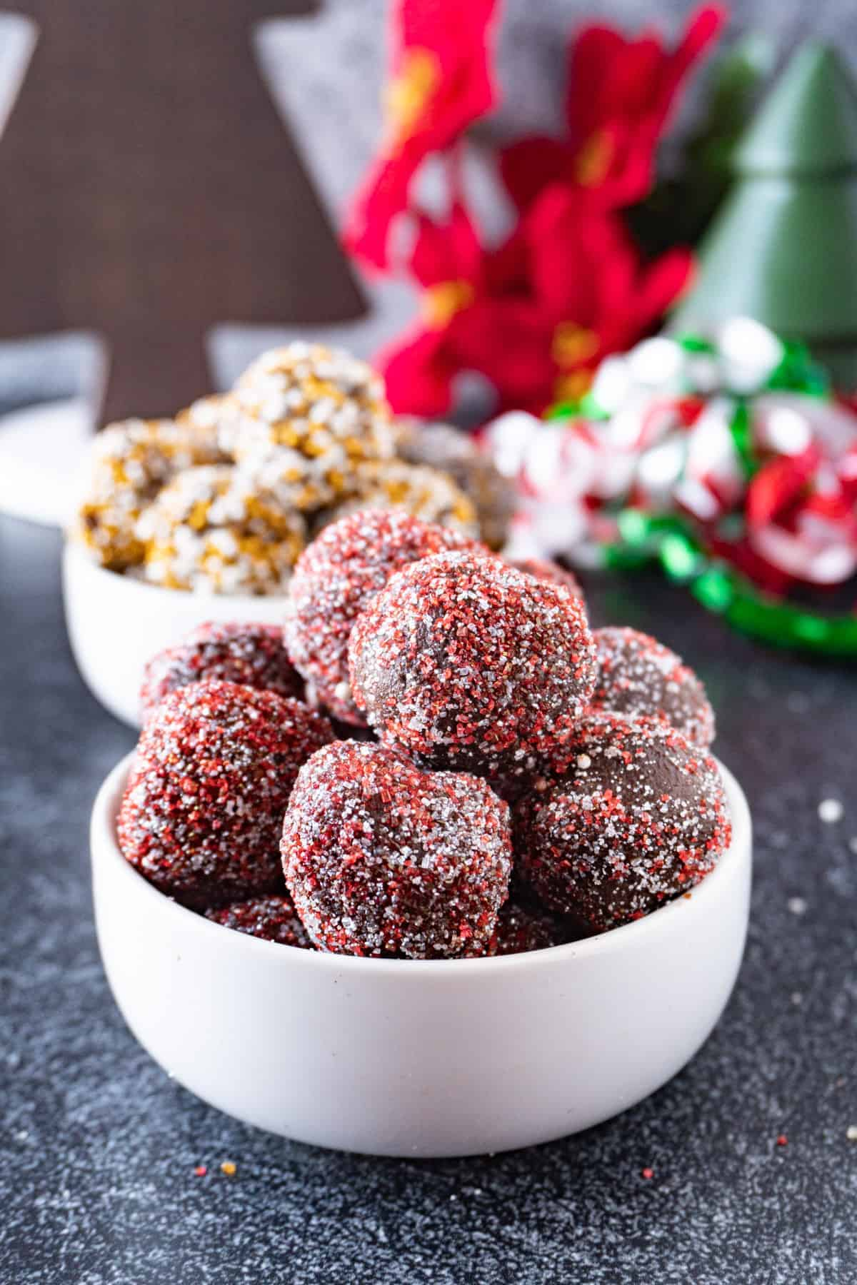 chocolate truffles with red sprinkles close up