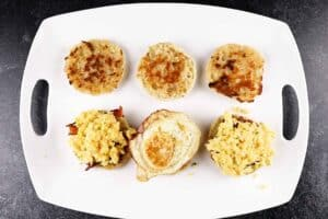 adding eggs to breakfast sandwich
