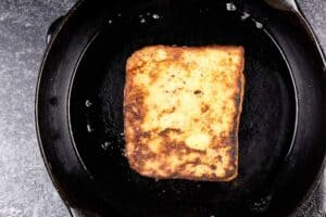 french toast in frying pan cooked to golden brown