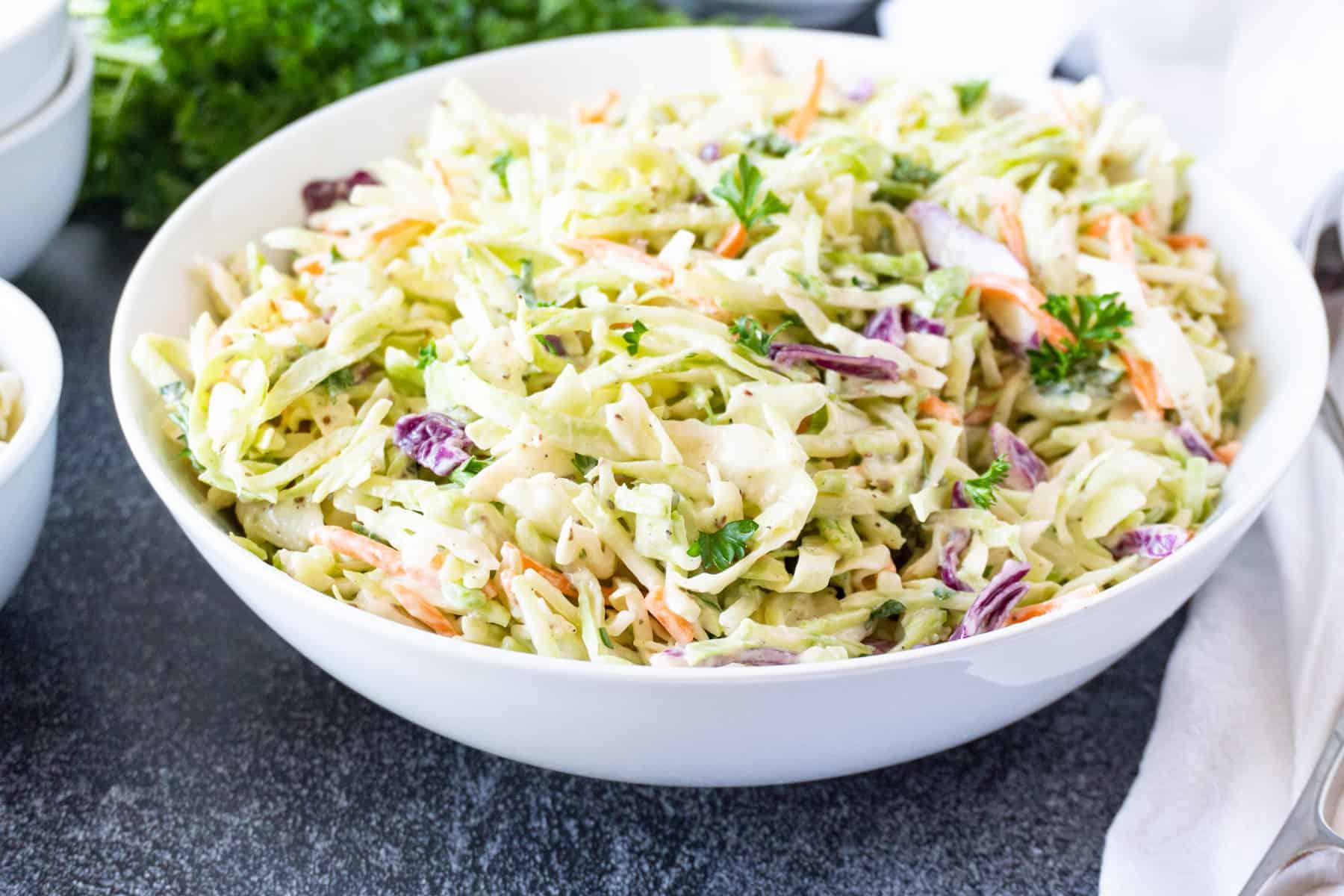broccoli slaw in large white bowl