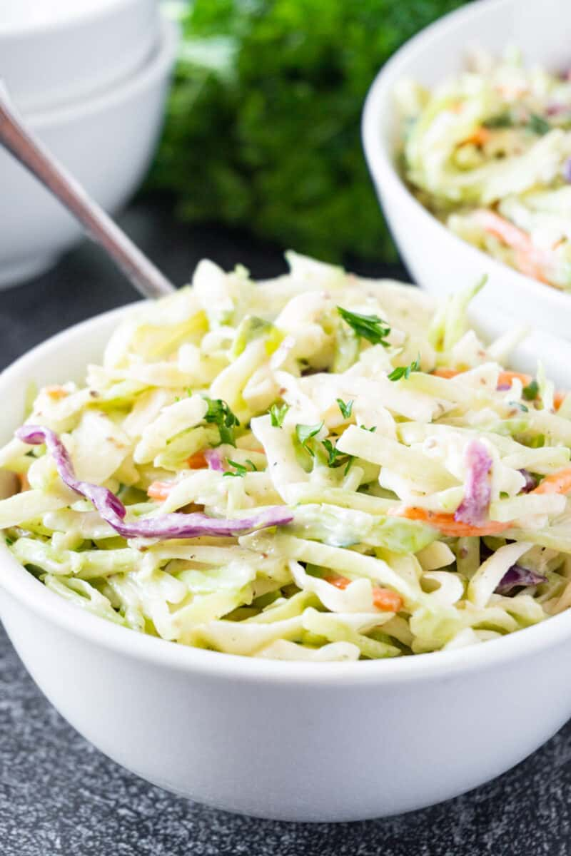 broccoli coleslaw in bowl with fork