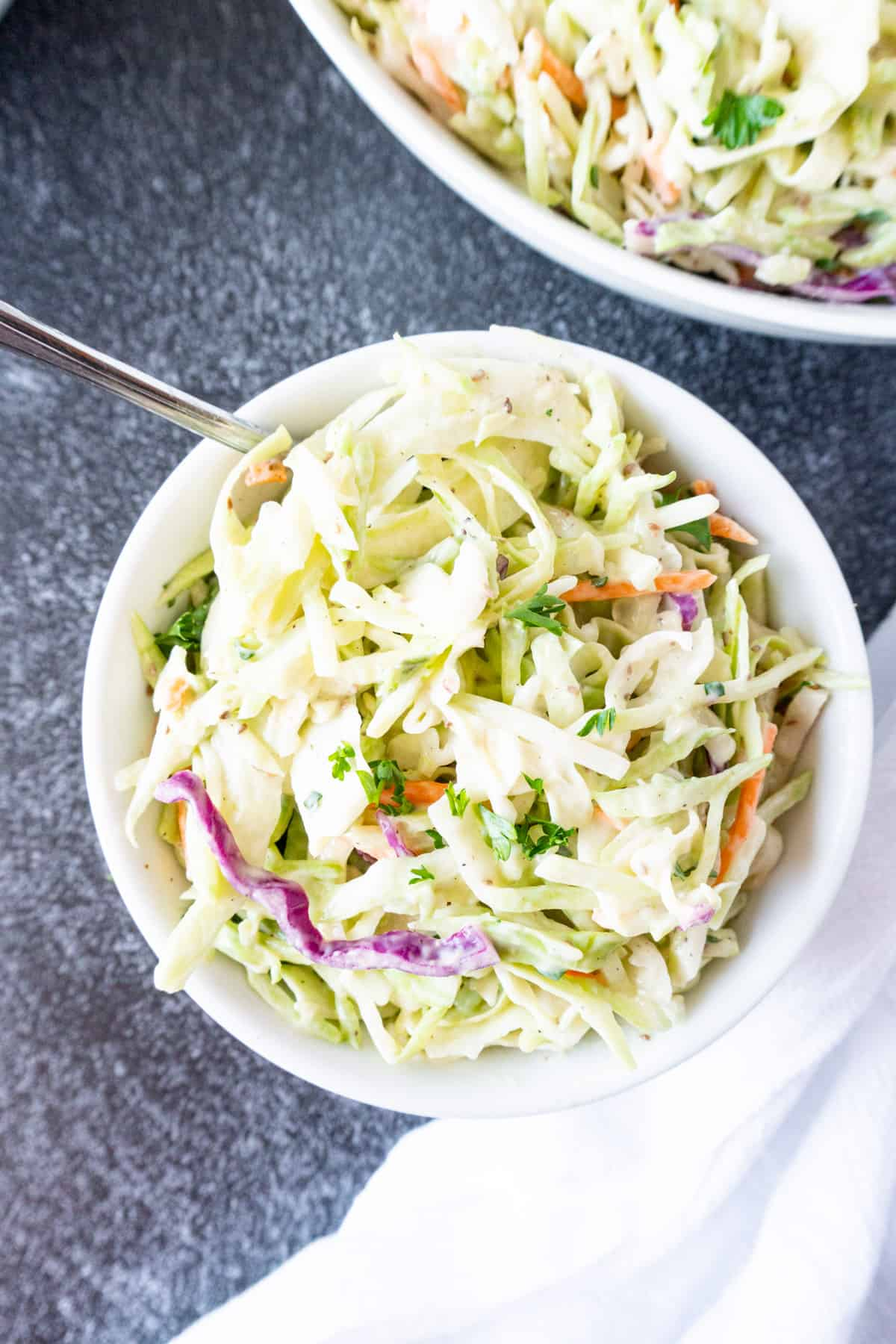 broccoli slaw in small white bowl