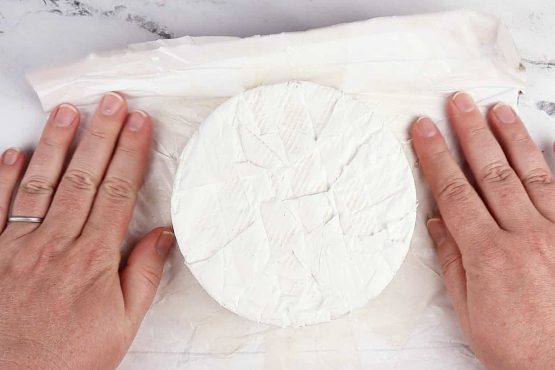 taking the wrapping off the brie