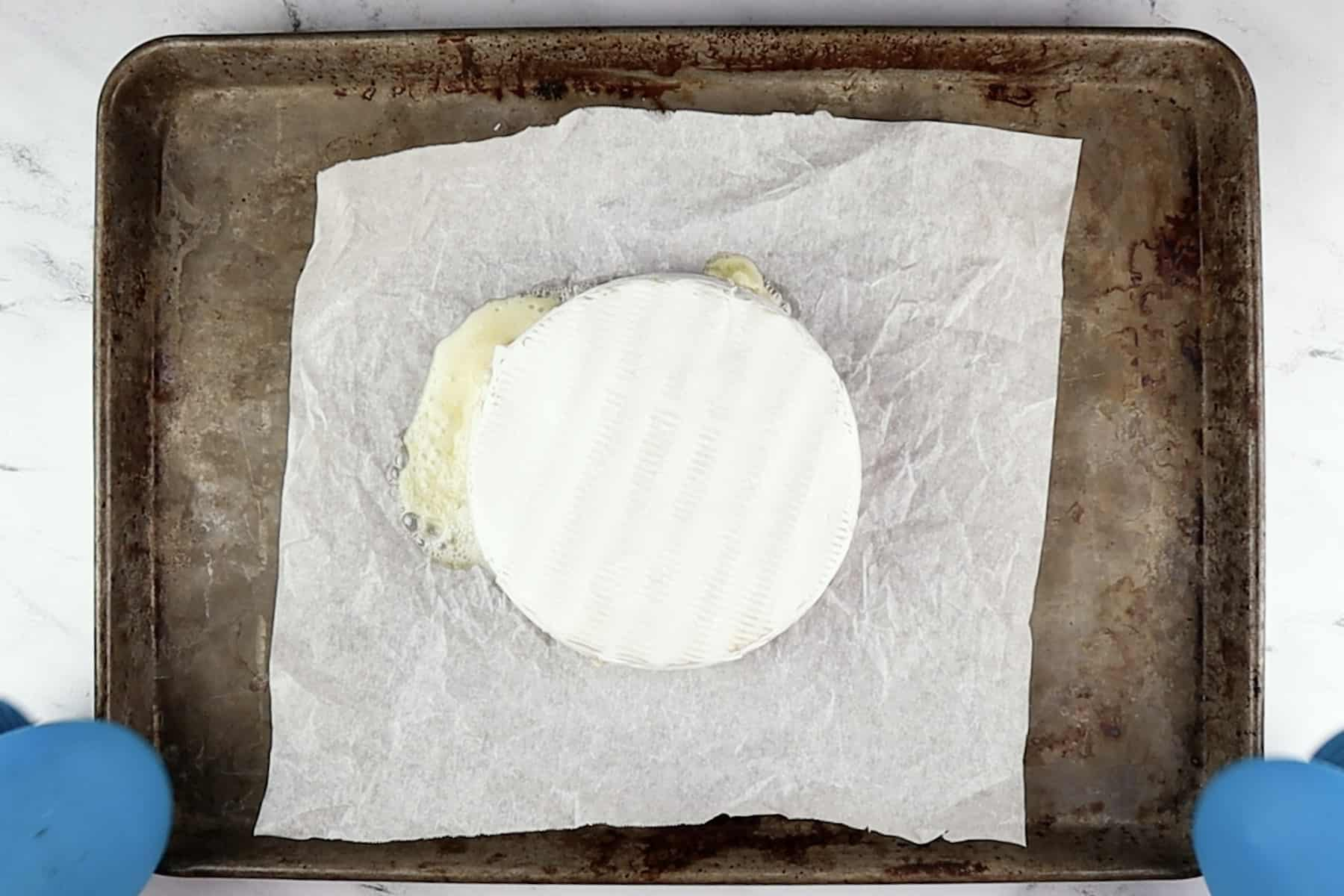brie baked and still on baking sheet