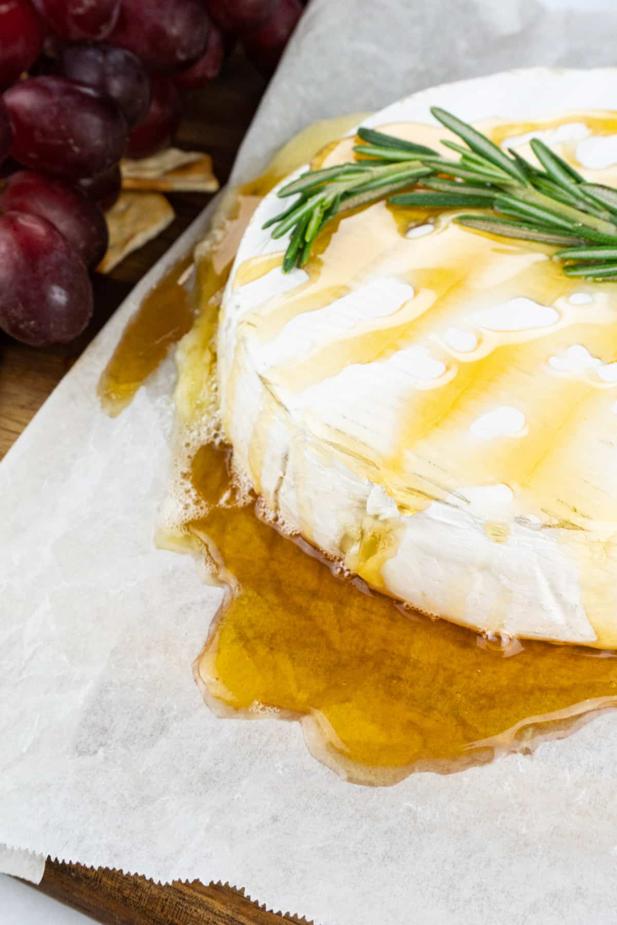 brie with honey and rosemary on top