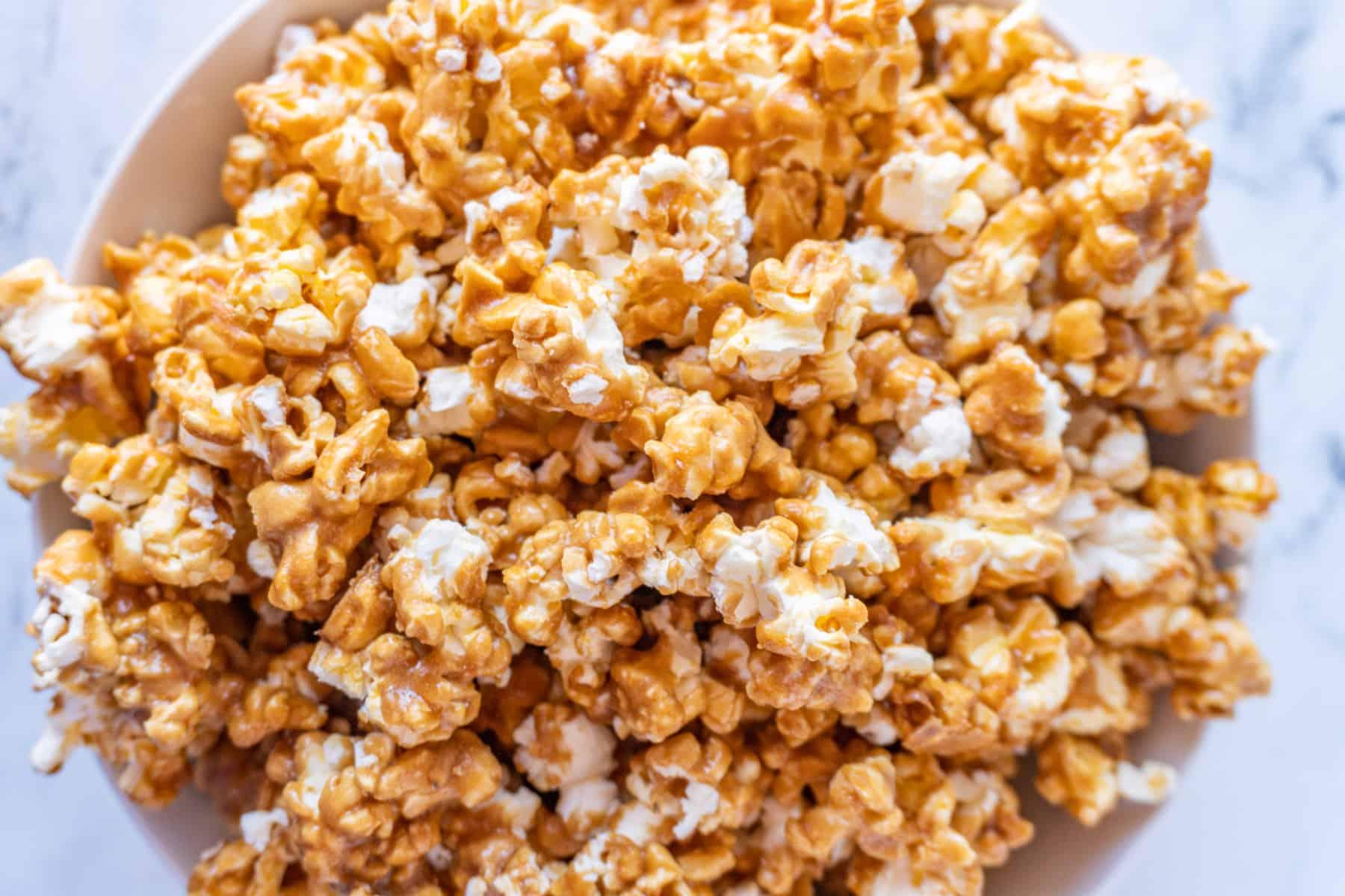 caramel popcorn in large bowl overhead shot