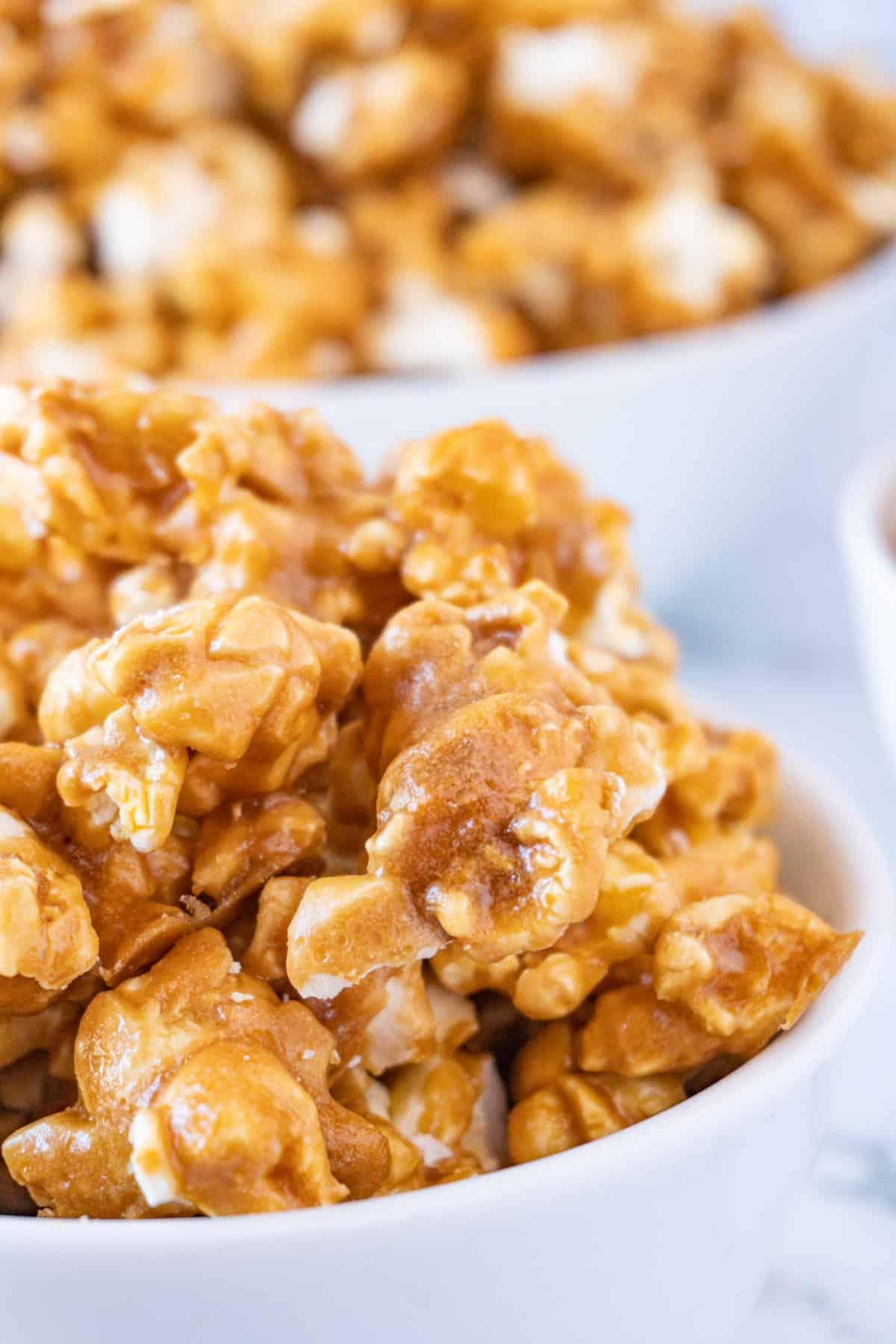 close up of caramel popcorn in bowl