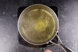 boiling the sugar, water, and orange juice