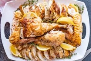 cut turkey on platter with lemons