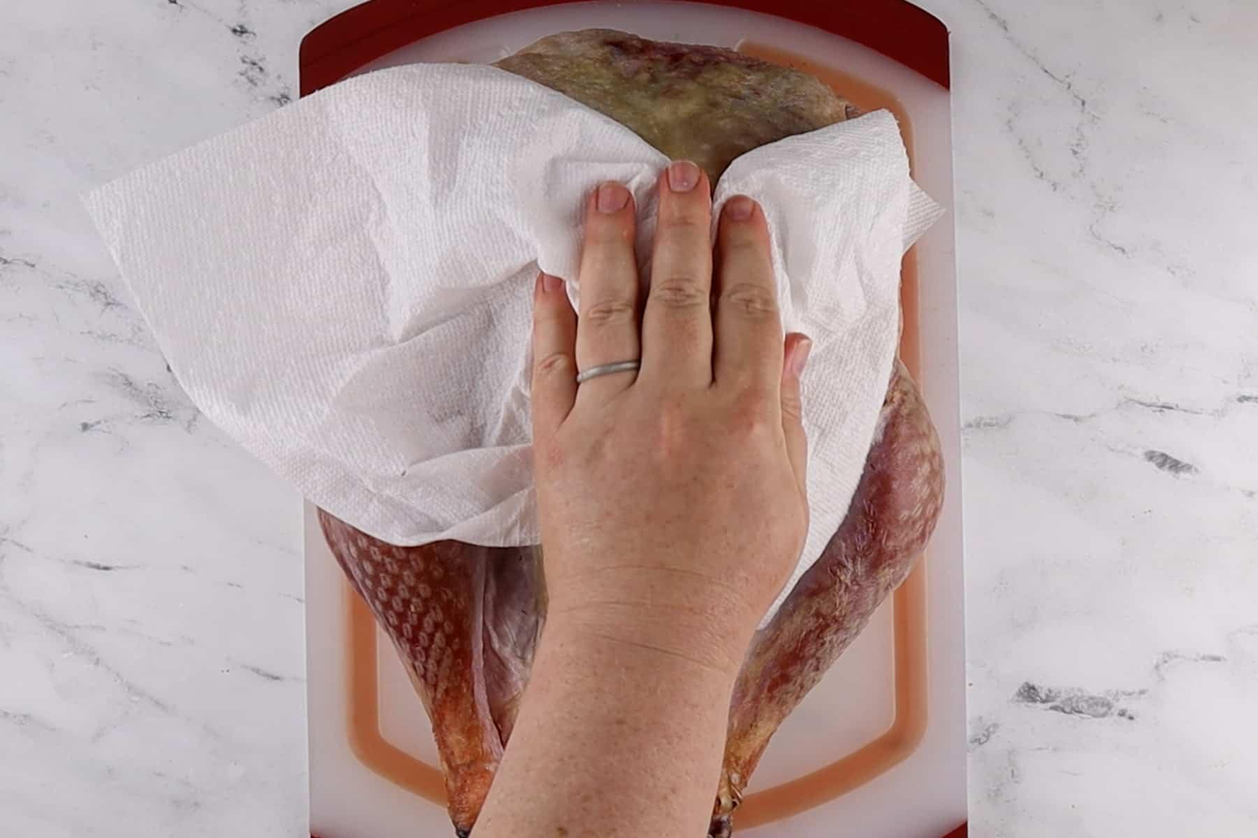 patting the turkey dry