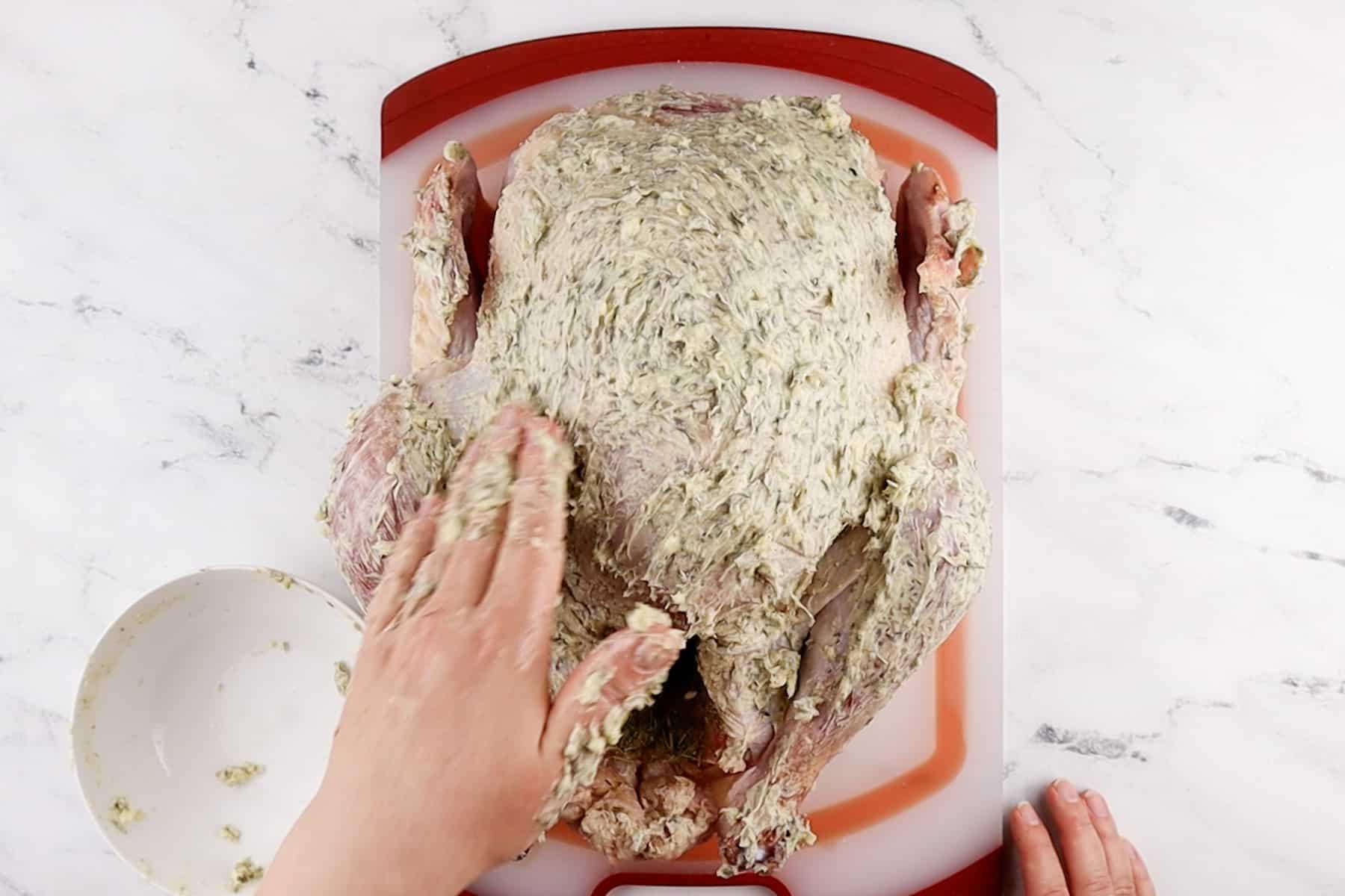 rubbing butter over turkey