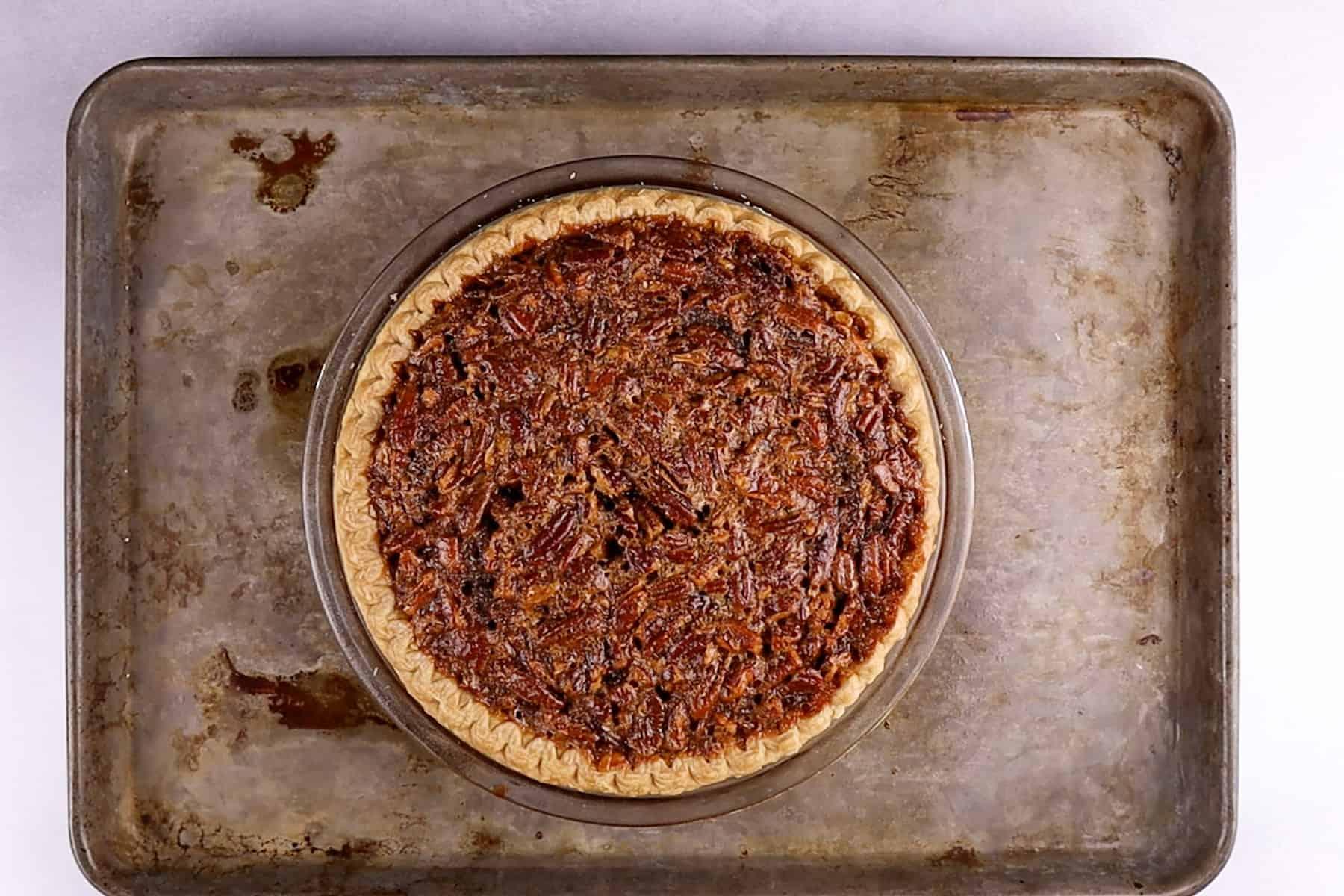 baked pecan pie on baking sheet