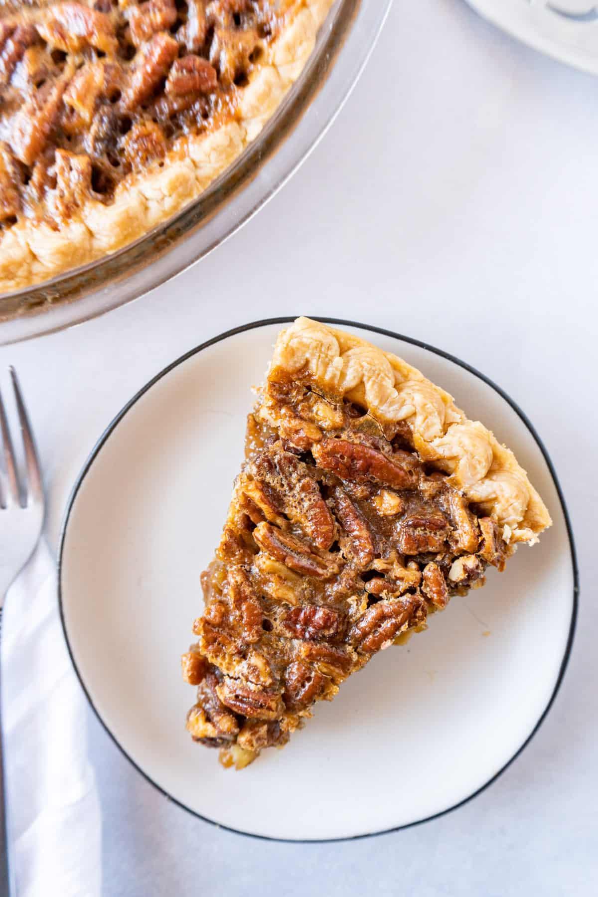 slicke of pecan pie on plate