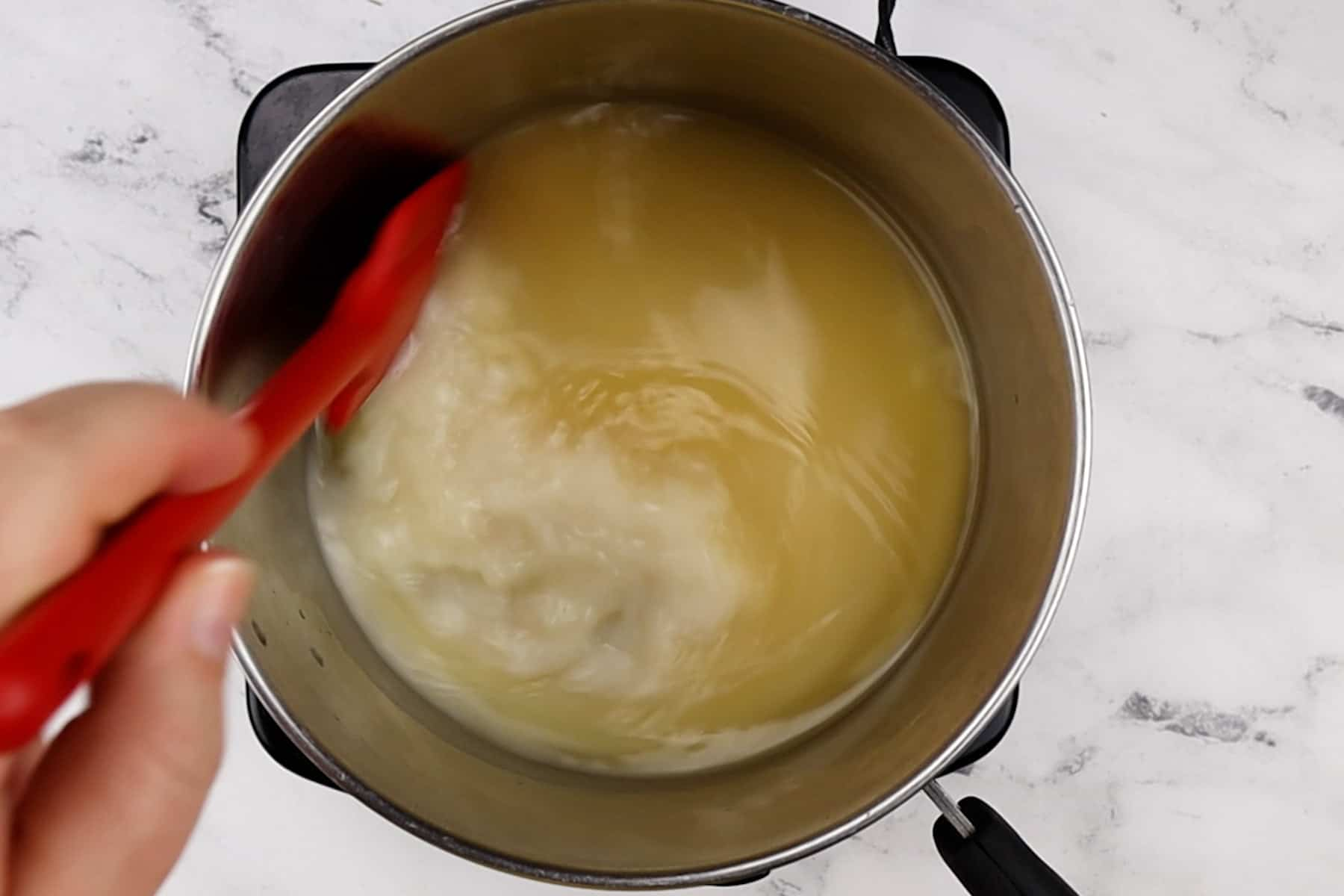 mixing broth and milk
