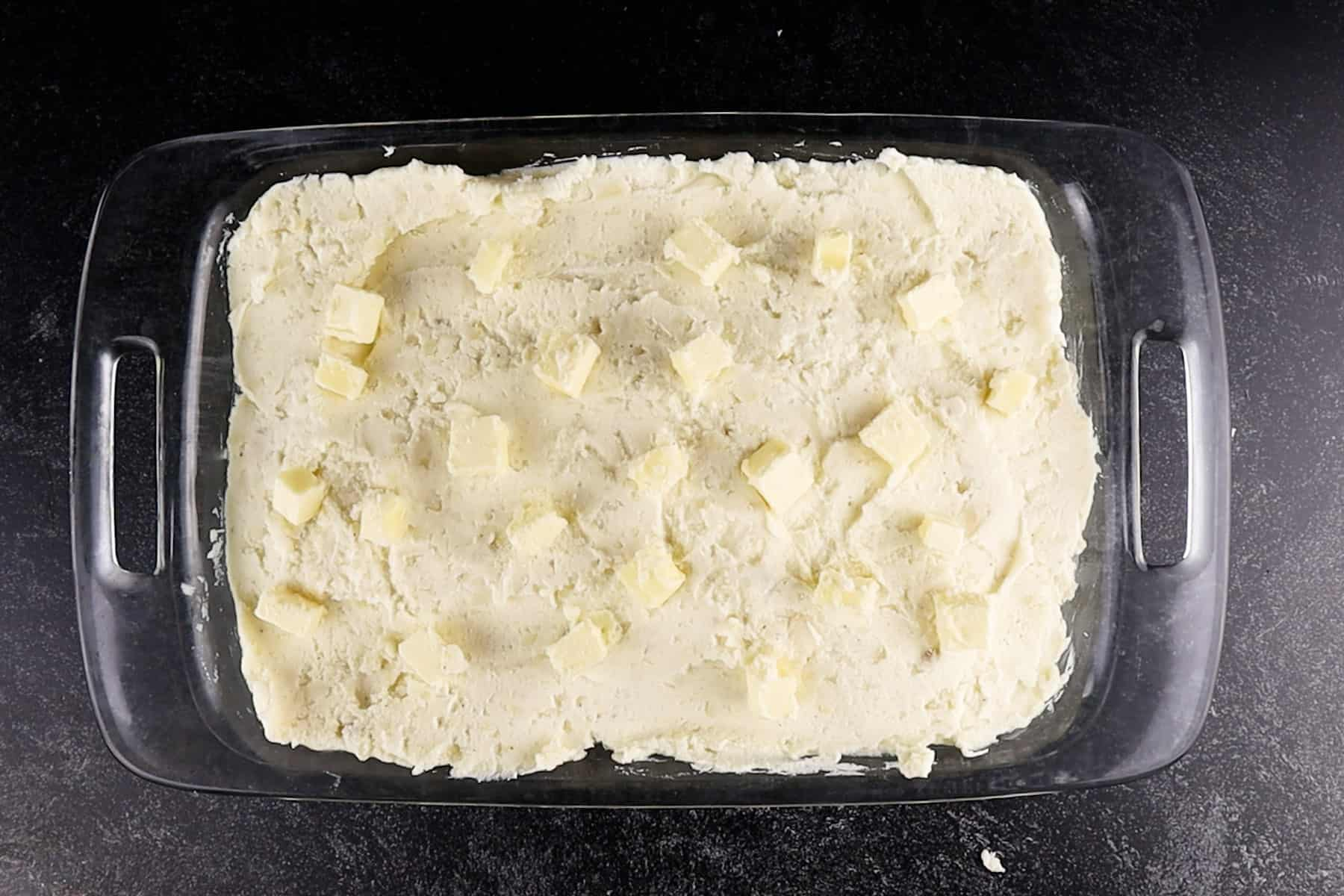 mashed potatoes dotted with butter