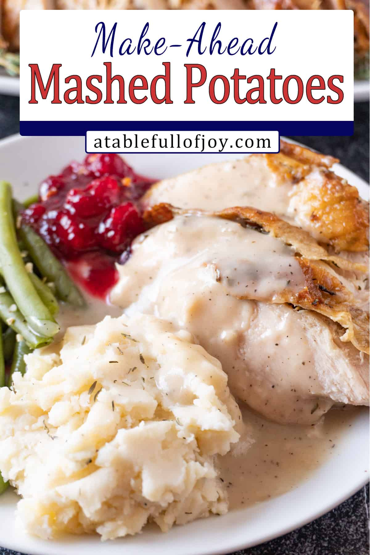 mashed potatoes on plate with turkey, gravy. cranberry sauce, and green beans pinterest pin