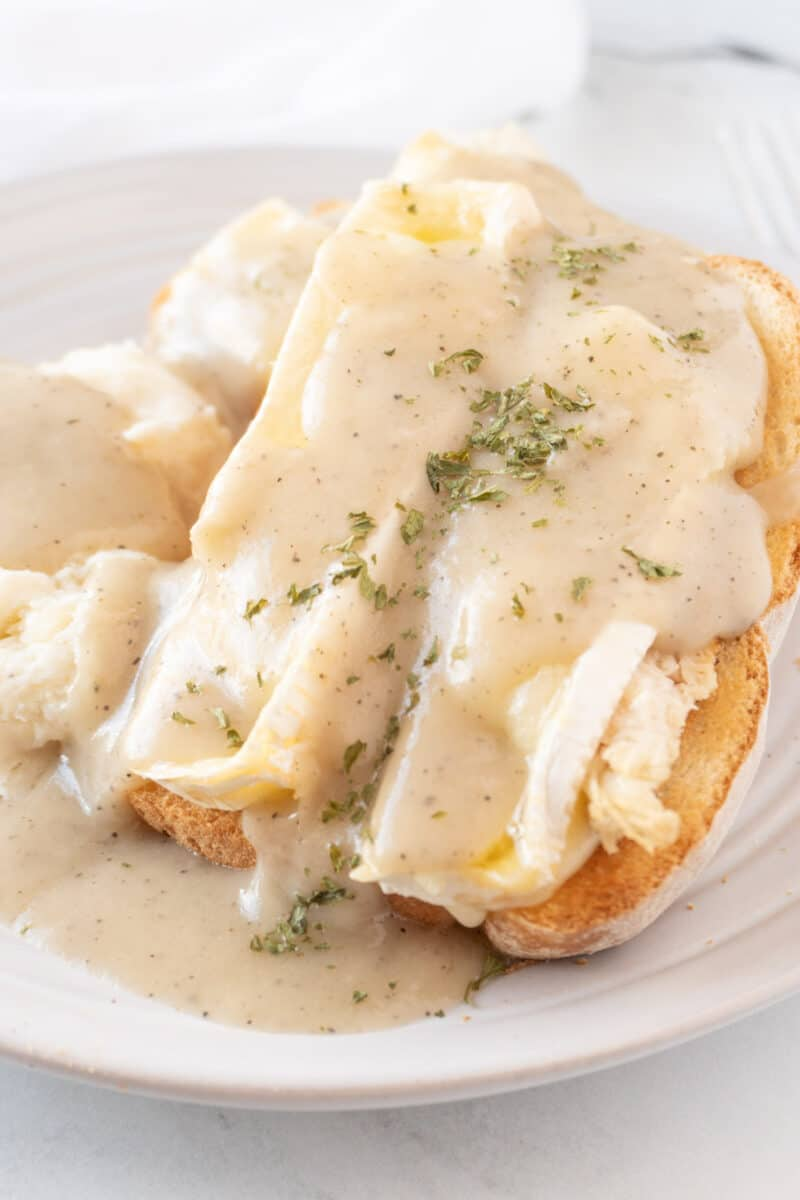 open faced turkey sandwich with brie and gravy