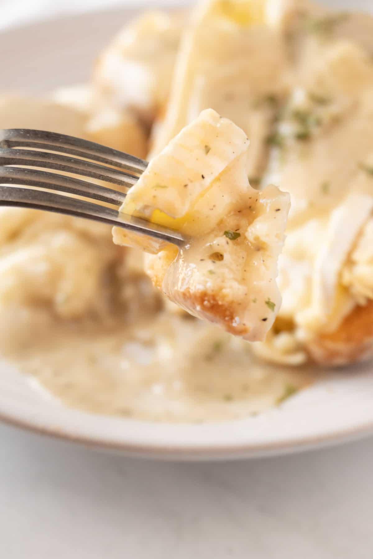 hot turkey sandwich with gravy on fork