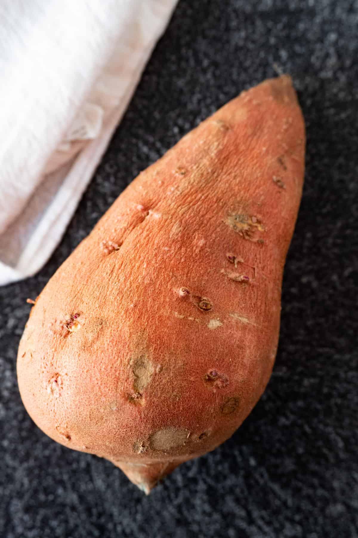 sweet potato and linen cloth