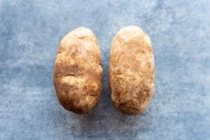 two russet potatoes side by side