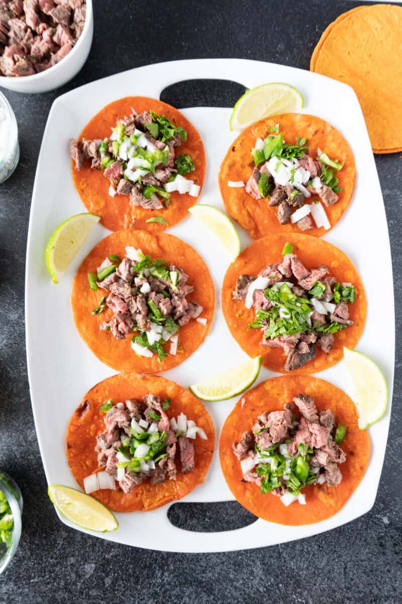 tacos al carbon on white platter