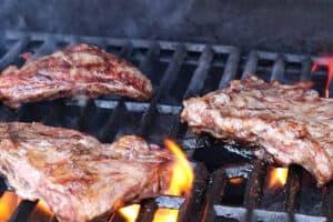 grilling steak on bbq