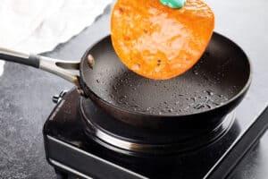 frying a tortilla in a frying pan