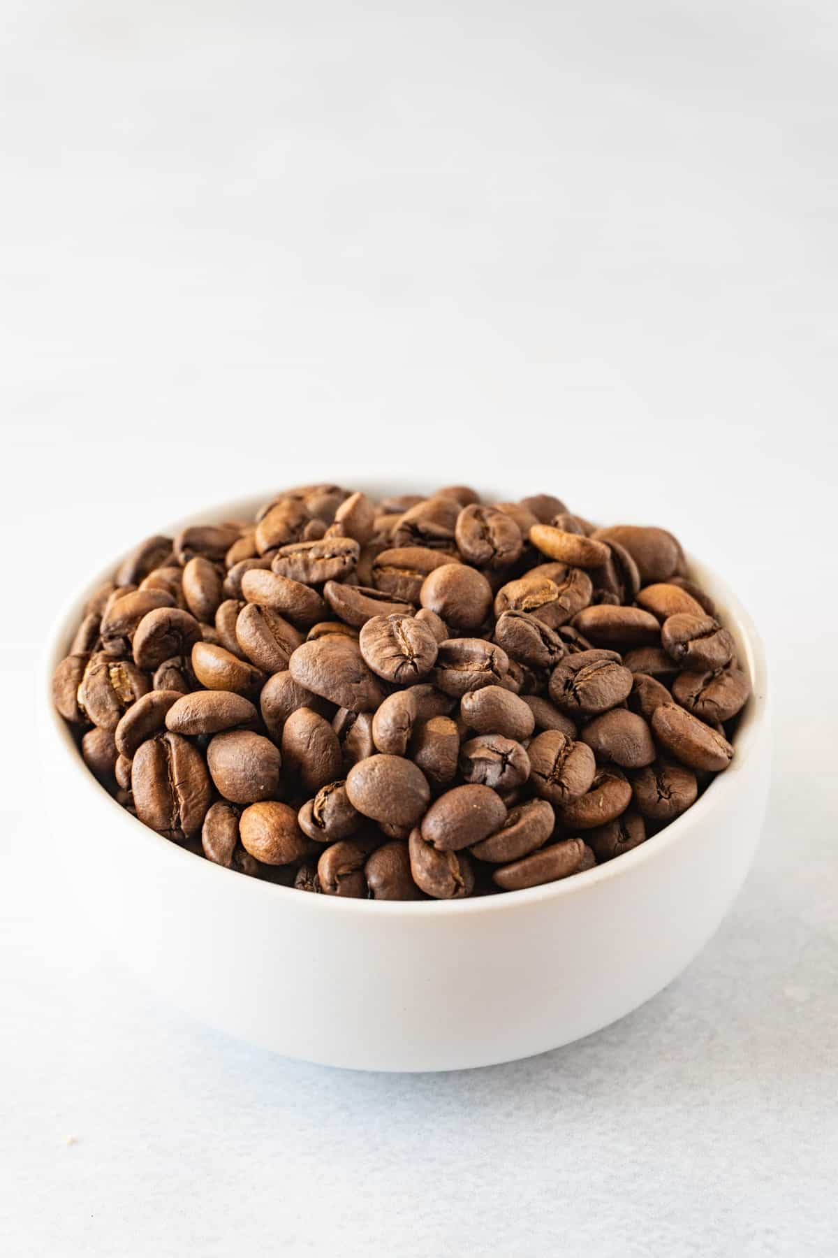 coffee beans in a white bowl