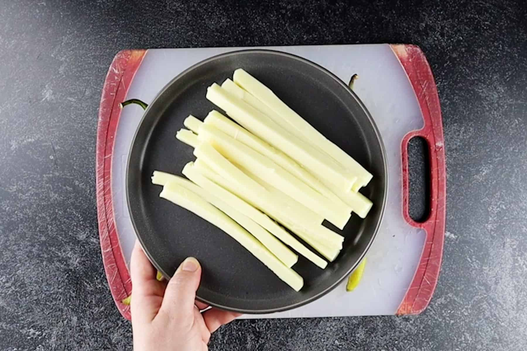 cheese cut into strips on plate
