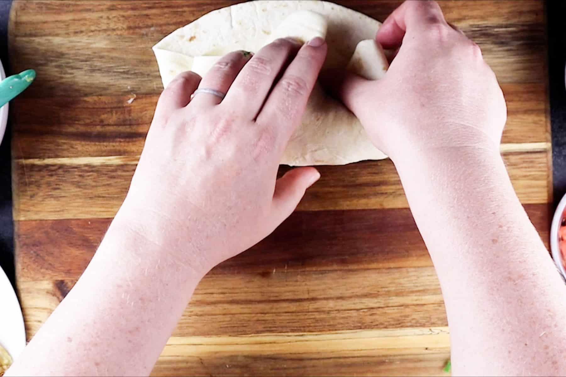 rolling a burrito
