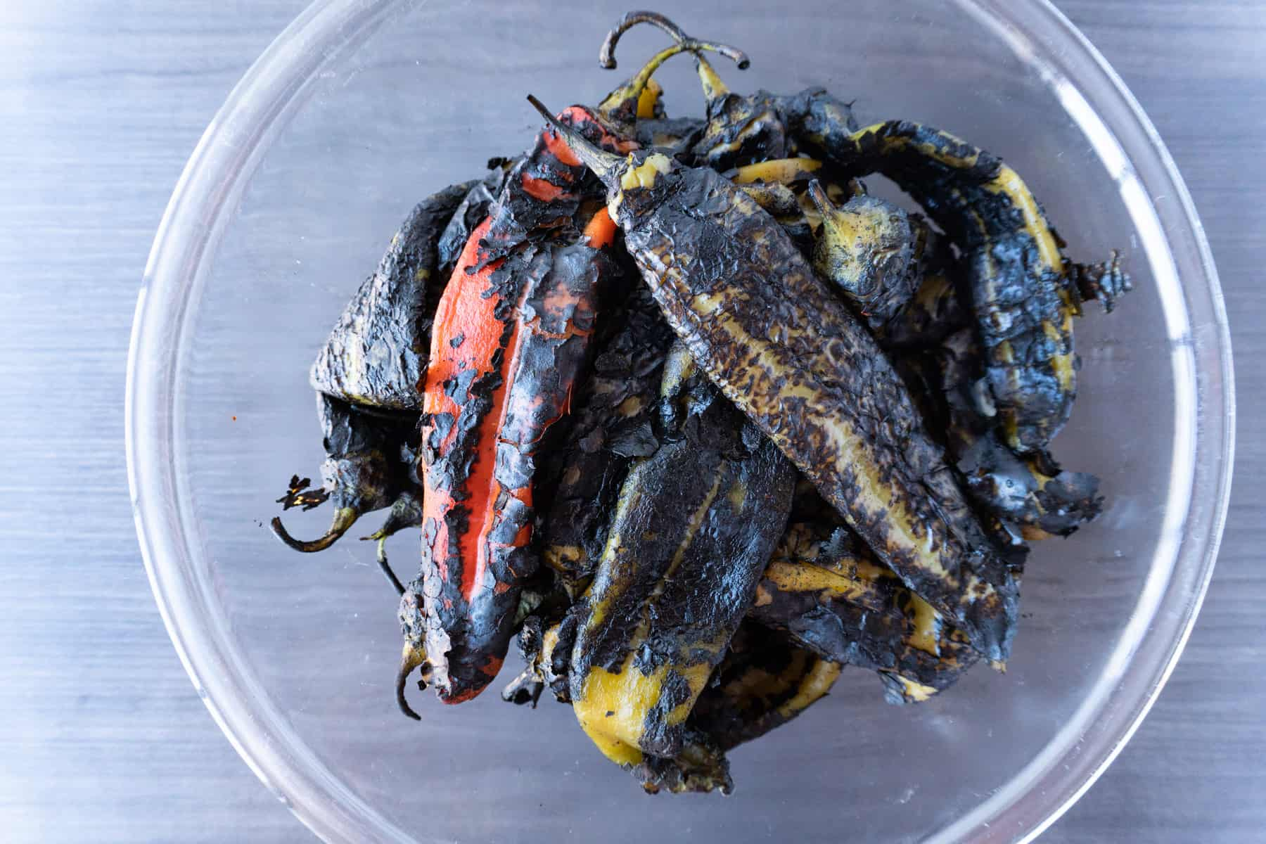 roasted green chile in in bowl with blackened skin