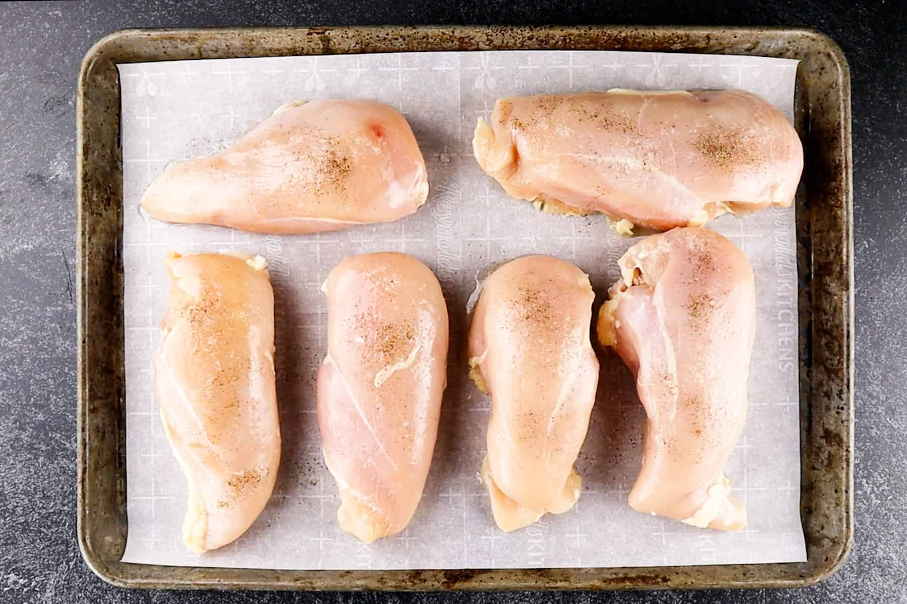 chicken breasts on baking sheet uncooked