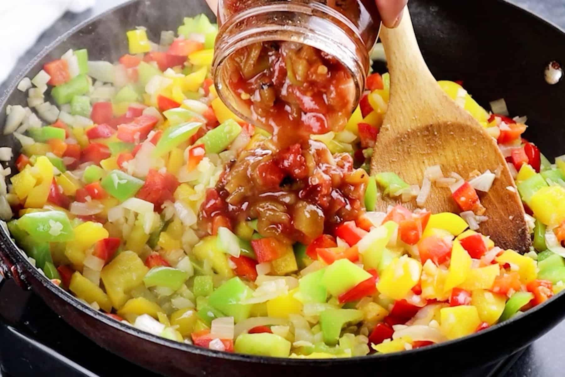 adding salsa to skillet
