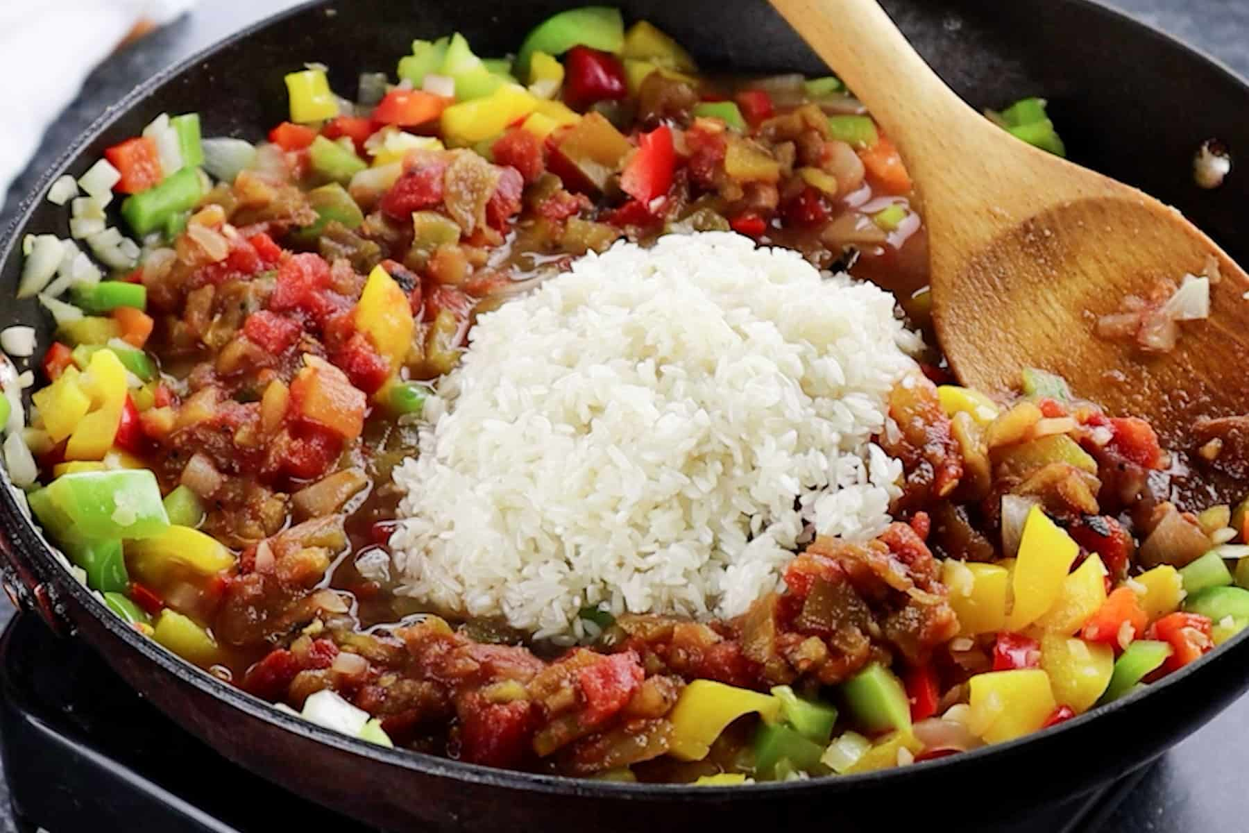 adding rice to skillet