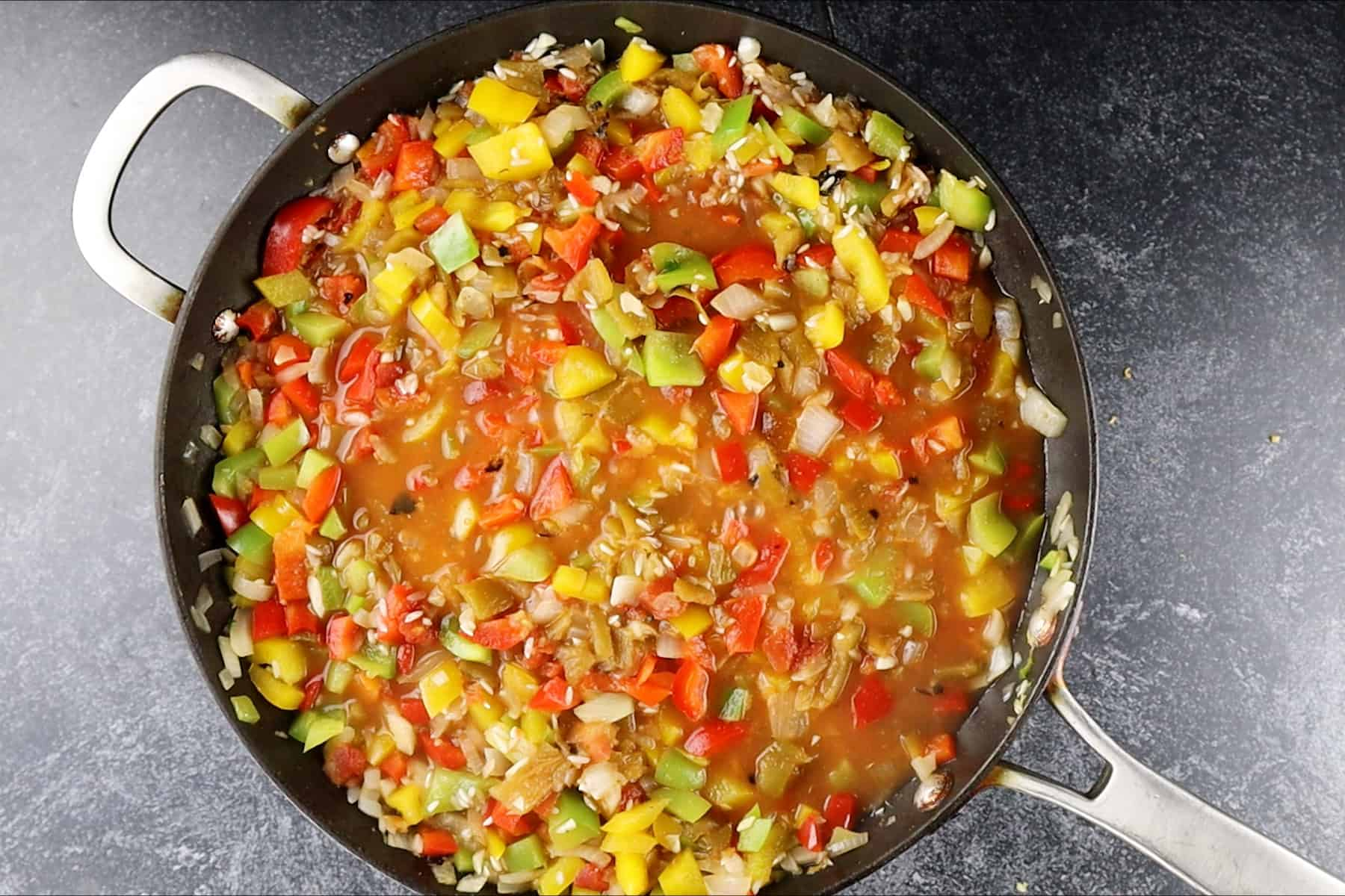 skillet with liquid simmering