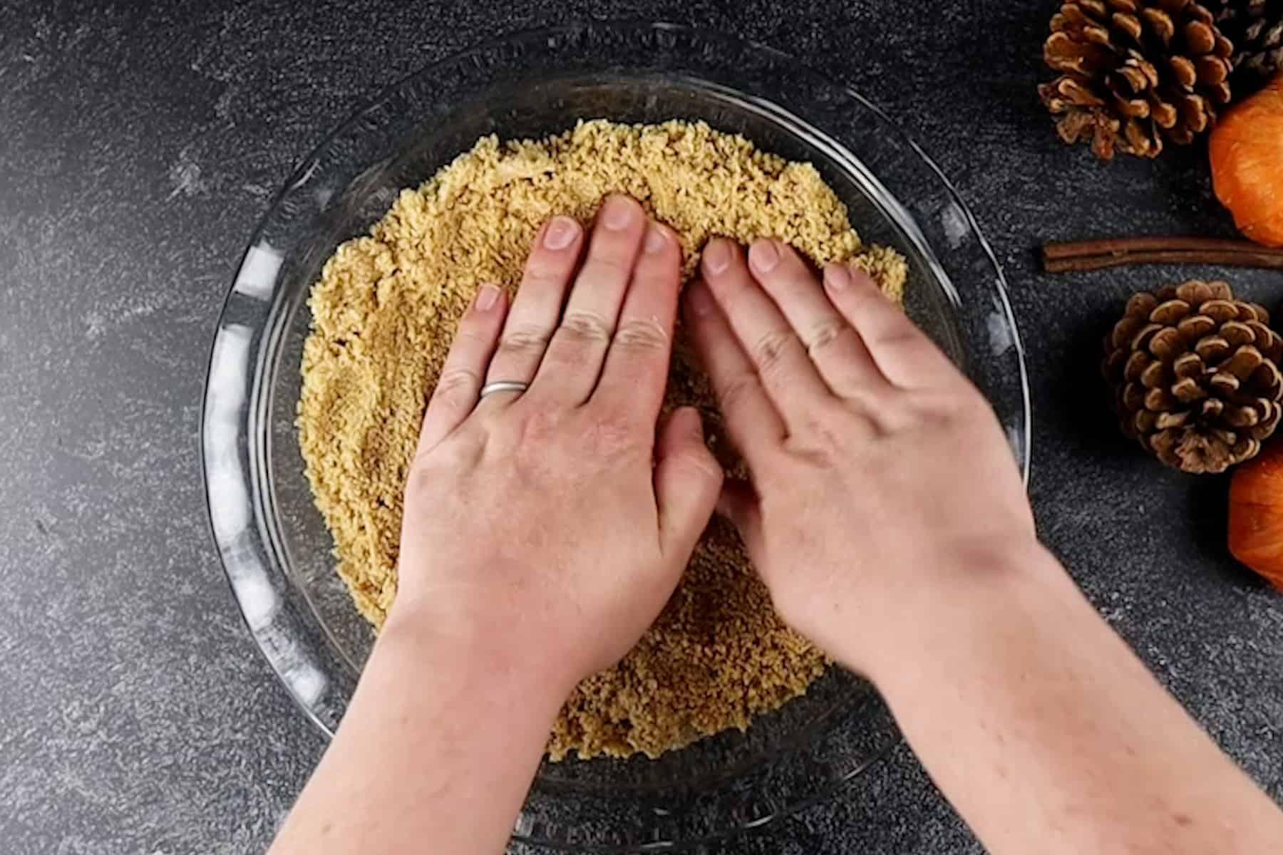 pressing in the graham cracker crust