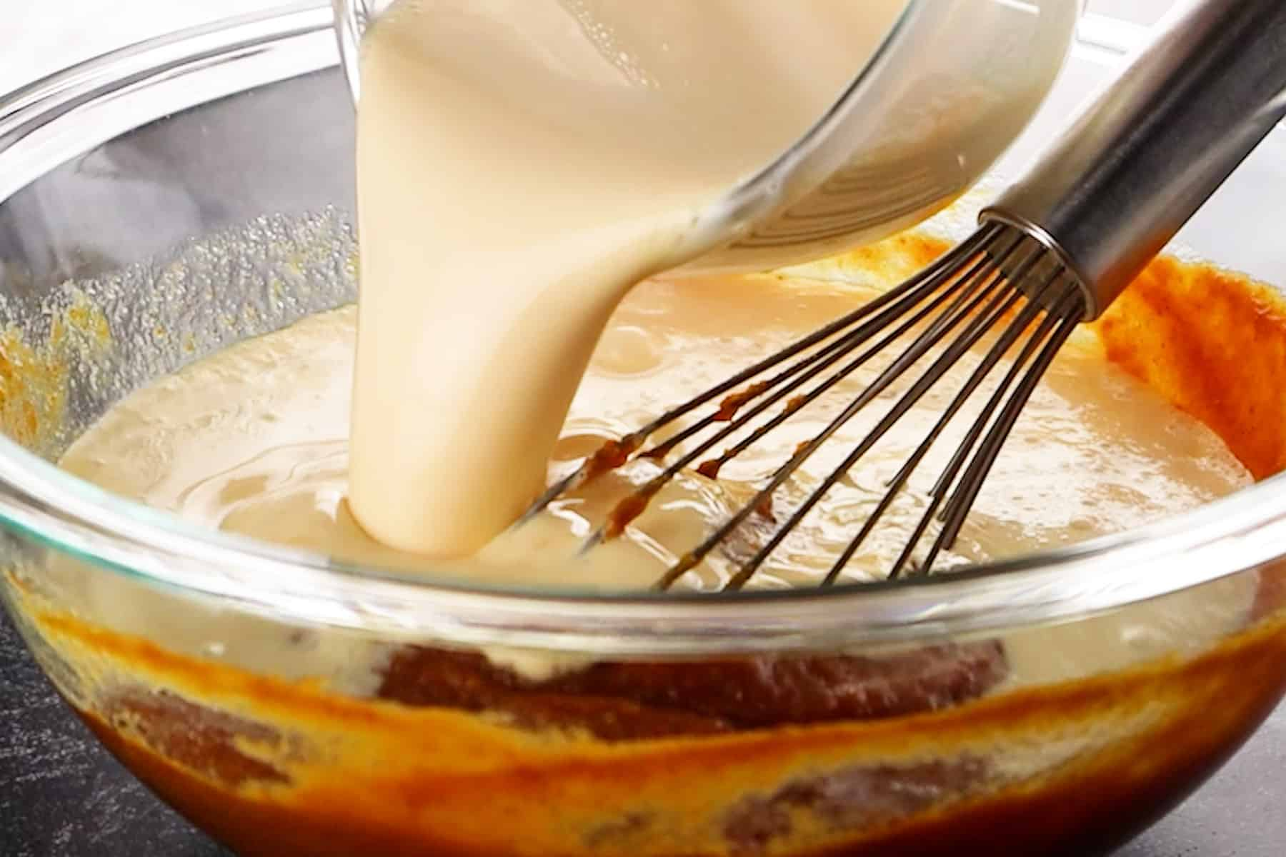 pouring into evaporated milk